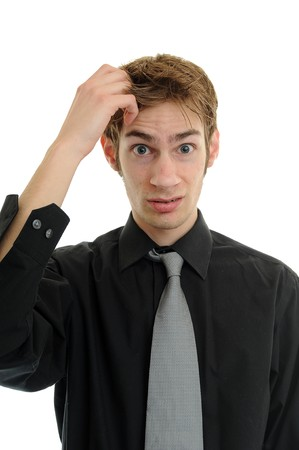 Young businessman scratches his head in confusion Stock Photo - 6918270