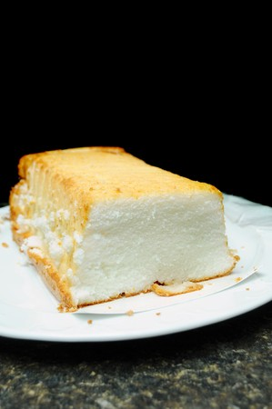 Angel food cake white short bread on a countertop isolated on black background above with room for you text.