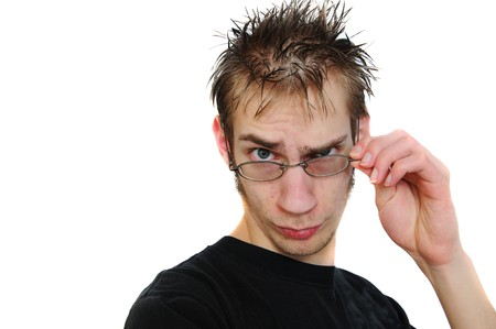 cliche': Portrait of a young adult with a cliche look of a tech (spikey hair and glasses) isolated on white background