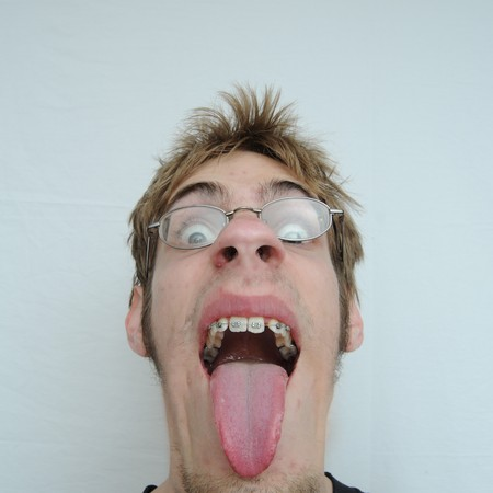 An ugly man with a huge mouth and tongue sticking out Stock Photo - 6975115
