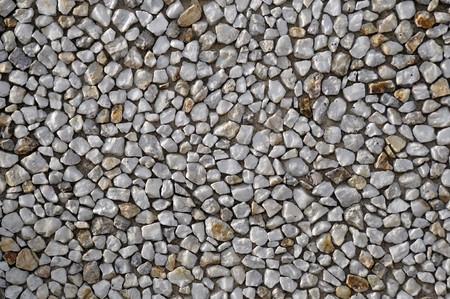 A bunch of white mineral rocks placed on a flat cement wall with the sun light shining on the sides of the rocks. This makes a great texture or background. Stock Photo - 7036584