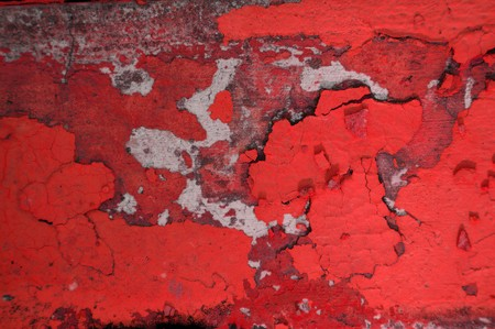 Worn and weathered crusted chipped red paint on textured cement Stock Photo - 7036585