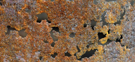 Rust texture originally from an old burn barrel. gritty brown and orange colors with holes. Stock Photo - 7036651