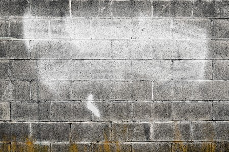 Worn out textured cement gray wall with some white spray paint on it and yellow decay on the bottom. Stock Photo - 7036654