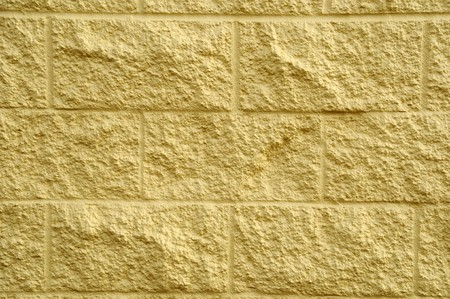 Worn out textured cement gray wall with some white spray paint on it and yellow decay on the bottom. Stock Photo - 7036650