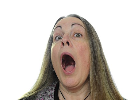 Woman screaming isolated over a white background.
