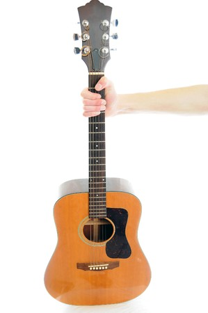 A hand and arm hold out an acoustic guitar Stock Photo - 7064620
