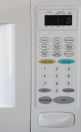 Closeup of a microwave and it's white buttons Imagens - 7064623