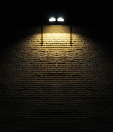 Old rough brick wall background texture with a spotlight shining on it Archivio Fotografico