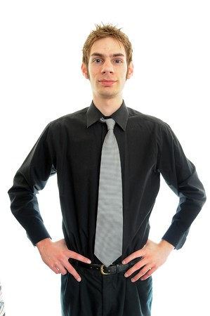 A young teenage man in a black dress shirt and a tie photo