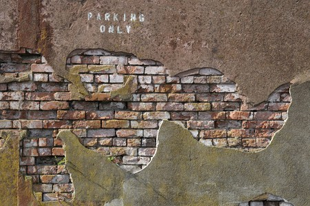 Old worn out brick wall with plaster partly covering them up. Stock Photo - 7111257