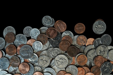 A whole bunch of American coins piled on top of one another to make this background. Isolated on black copyspace with room for your design or text. Stock Photo - 7111294