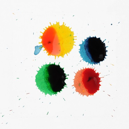 ink stain: Abstract closeup photograph of colorful ink and paint splotches, splatters, dabs, dribbles, and splatters isolated on a white background.