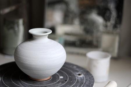 bygone: Several raku art pots inside of a pottery shop