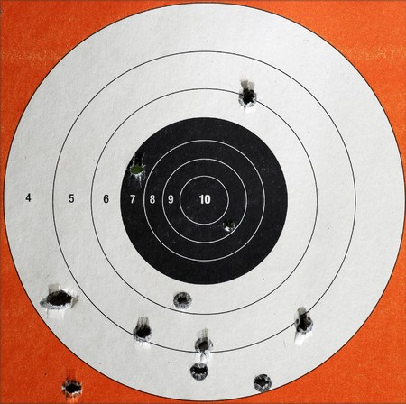 black hole: A Closeup of a practice target used for shooting with bullet holes in it.
