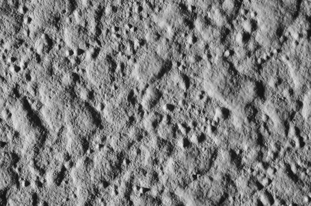This is a closeup macro shot of a wall with harsh side lighting to make it look like the surface texture of the moon photo