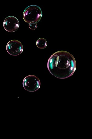 A bunch of bubbles isolated perfectly on a pitch black background. photo