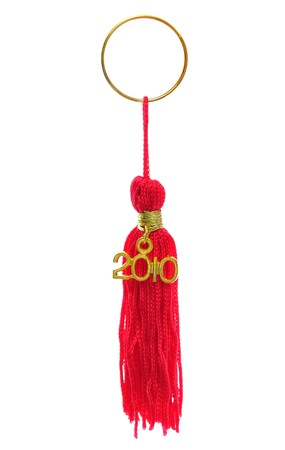 Red tassels on a golden key chain ring isolated on white background Stock Photo