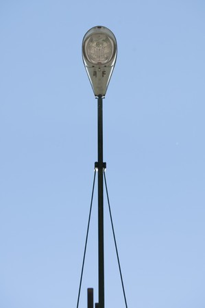 A below view of a street lamp against a blue sky. Stock Photo - 7300863
