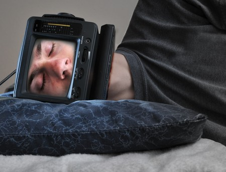 retro tv: A man with a TV on his head sleeping on his bed, off.