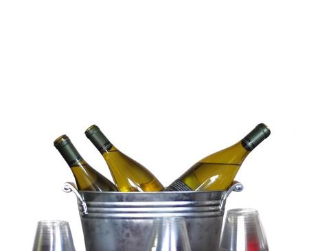 tin: Three wine bottles in a tin bucket isolated on white.