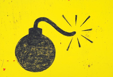 Bomb drawn in with a thick black marker on a yellow background. Stock Photo - 7393632