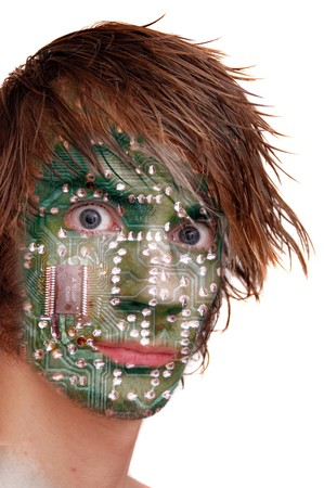 A computer chip design embedded on a young man's head. Stock Photo - 7421731