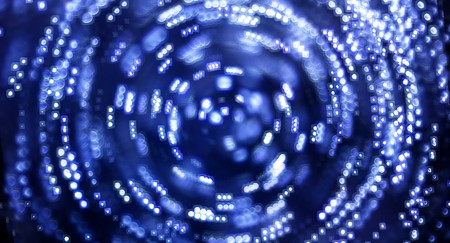 spinning: A blue swirl of lights spinning around. Stock Photo