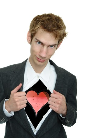 reveal: A young boyfriend in a business suit pulls open his clothing to reveal his heart with a smirk on his face. Stock Photo