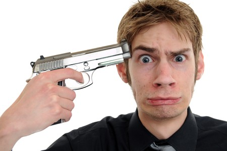 Frusterated employee holds gun up to his head photo