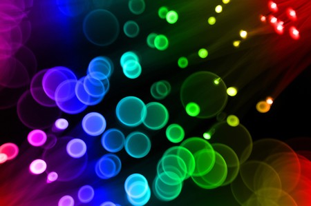 A blurry defocused background with round glowing circles as the bokeh shape with rainbow color