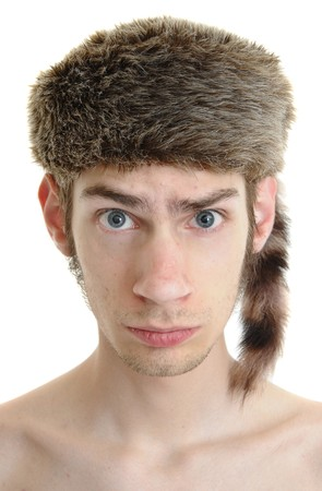 hick: A white young male wears a raccoon hat isolated on white background Stock Photo