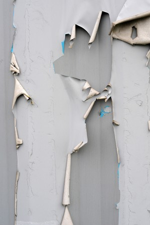 pealing: Torn ripped gray metal texture background with paint and metal pealing off. Stock Photo