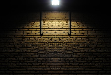 dirty room: Old rough brick wall background texture with a spotlight shining on it Stock Photo