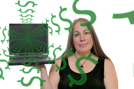 A woman holding up a computer with dollar symbols coming out of the screen Stock Photo