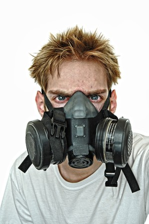 A young man wearing a protective gas mask. Harsh hardcore grunge contrast and tonemapping. photo