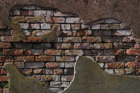 Old worn out brick wall with plaster partly covering them up.