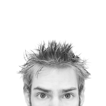 on both sides: Highkey portrait of a young man staring ahead with isolated white copyspace above and on both sides.