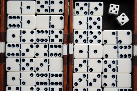regimented: Closeup of a dominoes laying on a flat surface. Stock Photo