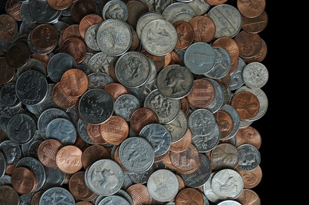 A whole bunch of American coins piled on top of one another to make this background. Isolated on black copyspace with room for your design or text. Stock Photo - 7680053
