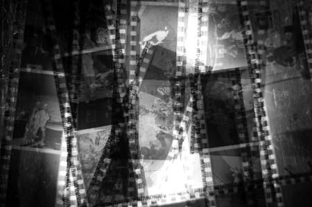 macro film: A bunch of 35mm negative filmstrips sitting on a  back light.