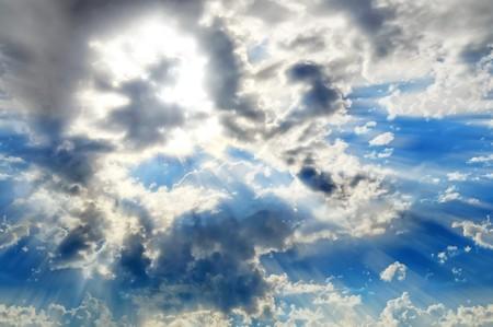 A heavenly sky with a sun bursting with light rays