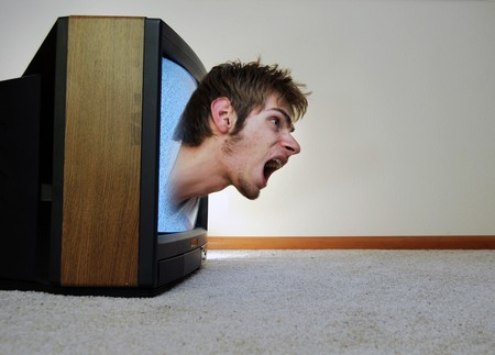 trapped: A man trapped inside of a TV, screaming for help to get out Stock Photo