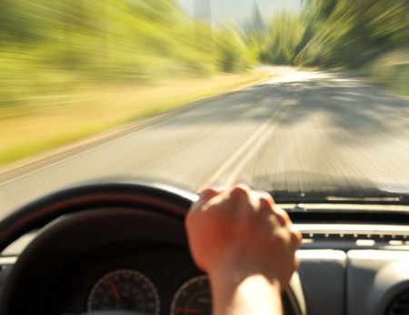 Driving inside a car on a country street, Speeding zooming fast down the road. photo