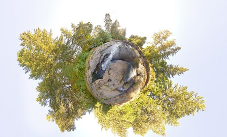 pano: A little tiny planet of an earhtly rocky river with trees and sky Stock Photo