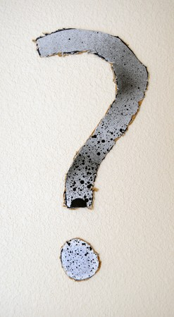 A cardboard question mark cut out and stck on a painted wall. Stock Photo - 7724100