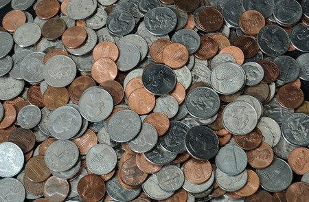 A whole bunch of American coins piled on top of one another to make this background Stock Photo - 7724126