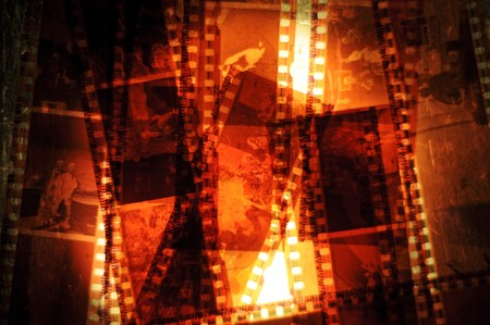 macro film: A bunch of 35mm negative filmstrips sitting on a  back light.