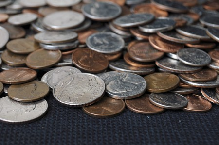 A whole bunch of American coins piled on top of one another to make this background. Shallow depth of field. Stock Photo - 7850373