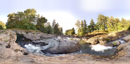 equirectangular: A little tiny planet of an earhtly rocky river with trees and sky. This is a complete 360 equirectangular panorama that can be freely offsetted, repeated into a pattern, or remapped. Stock Photo